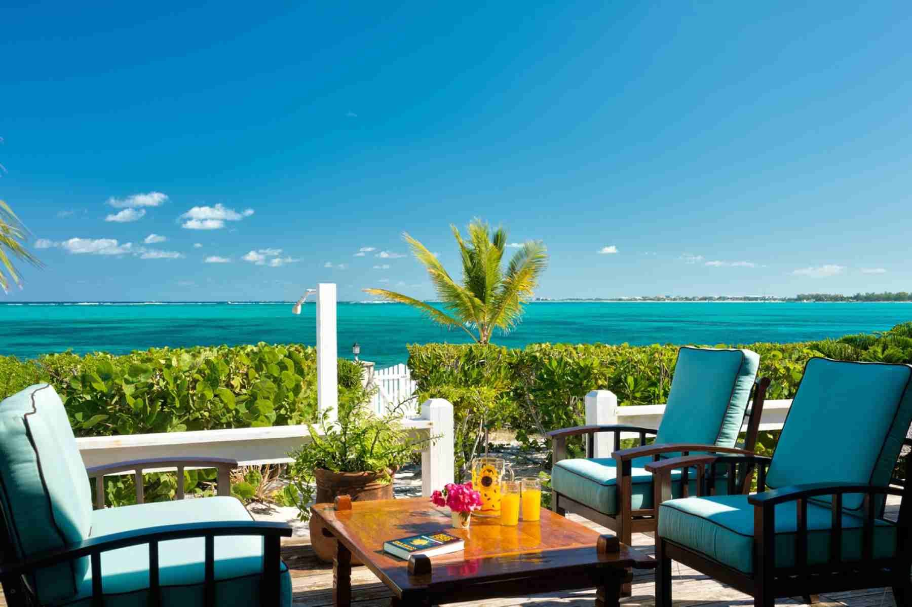 Reef beach house vacation rental villa turks and caicos for Beach house construction cost
