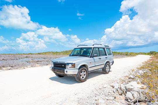 Jeep on beach in providenciales, Turks and caicos