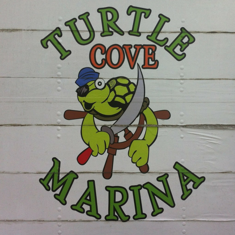Turtle Cove Marina Sign Providenciales Turks and Caicos